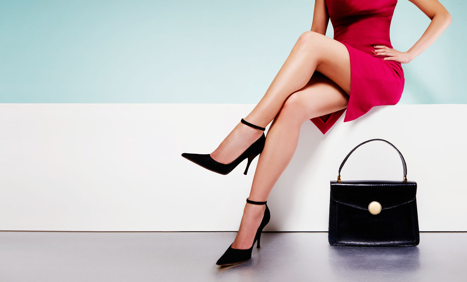women in red dress with black purse